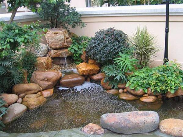 庭院假山鱼池设计图片欣赏 - 蓝天庭院假山设计